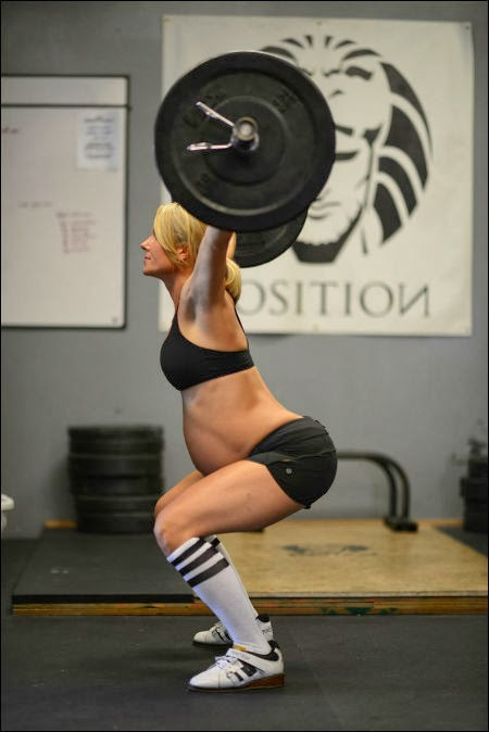 Photo of Lea-Ann Ellison lifting weight