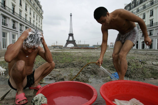 Workers shower at a construction site in Tianducheng