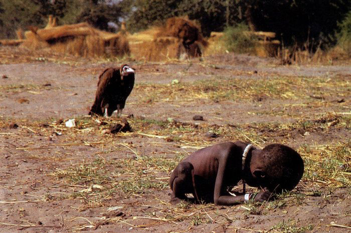 Starving Sudanese child being stalked by a vulture