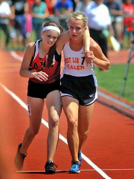 When this girl turned around during a race to help a girl who had fallen down. That girl was her opponent