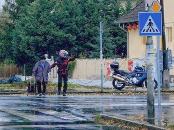 When this motorcyclist got off his bike to halt traffic, so that an elderly woman would make it to cross the street.