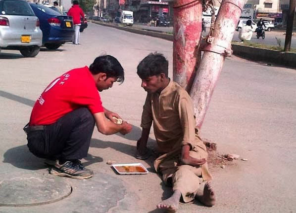 When this shop owner left his business for a while to feed this disabled homeless man.