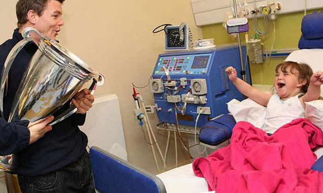 When Brian O'Driscoll, this girls hero, visited her in hospital.