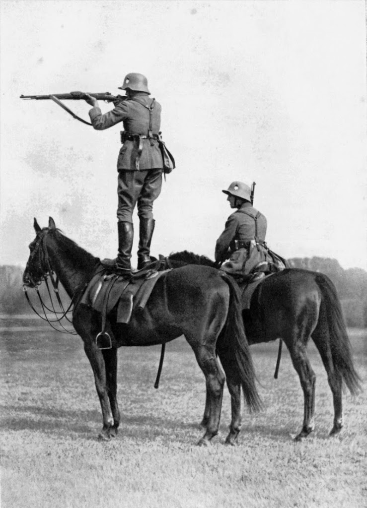 1935, German soldier takes while on the back of a trained horse