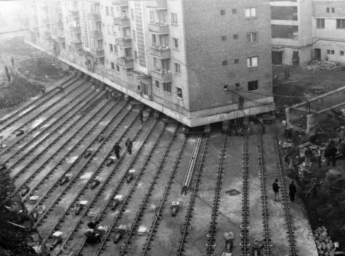 Moving a 7600 ton apartment building to create a boulevard in Alba Iulia, Romania, 1987