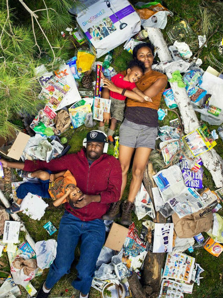 Photos Of People Lying In The Trash They Produce In A Week