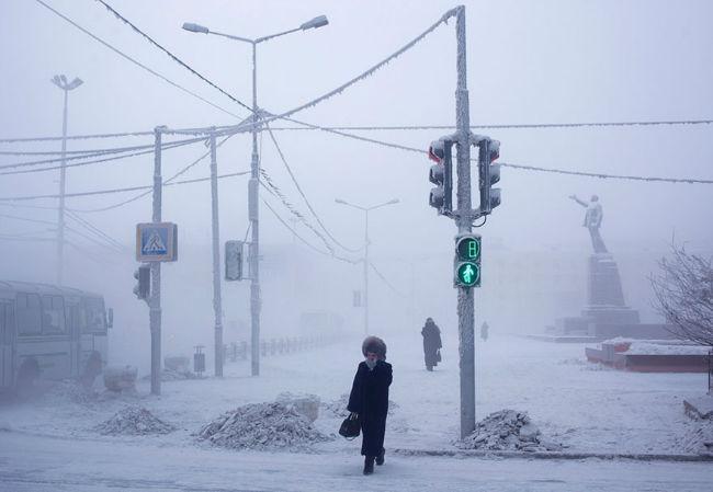 A resident of Oymyakon crosses a snowy streetlogspot.com