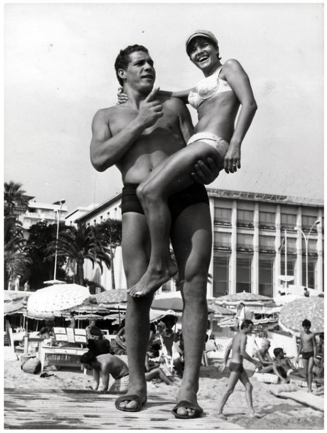Andre holding a woman