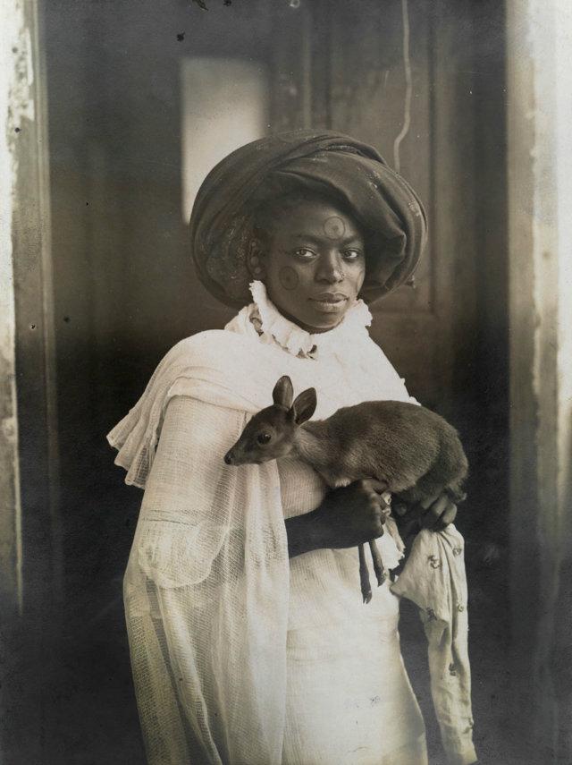 kenyan woman with pet deer