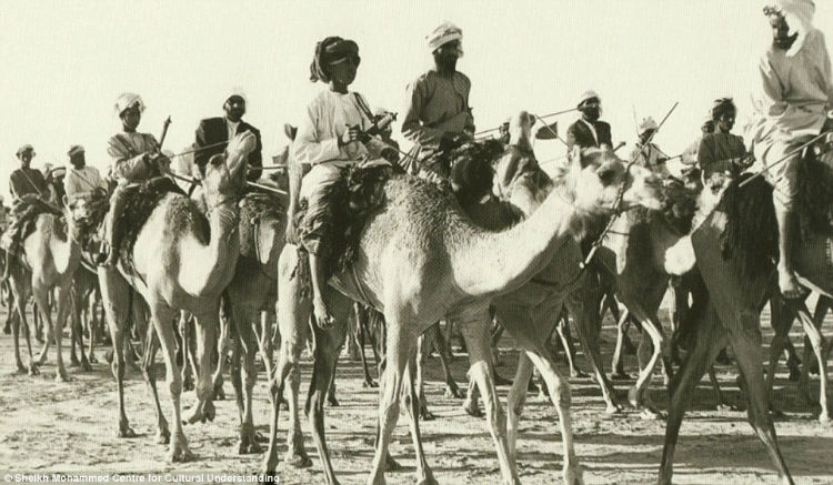 A camel caravan passing through the desert