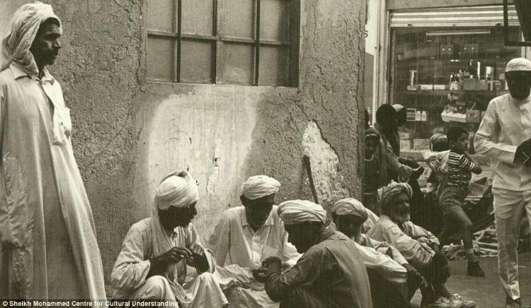 Men gathered in al-Naif souq