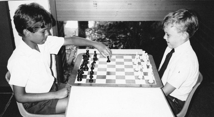 Heath Ledger on the right in a chess game