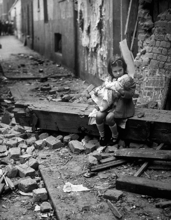 Little girl comforting her doll