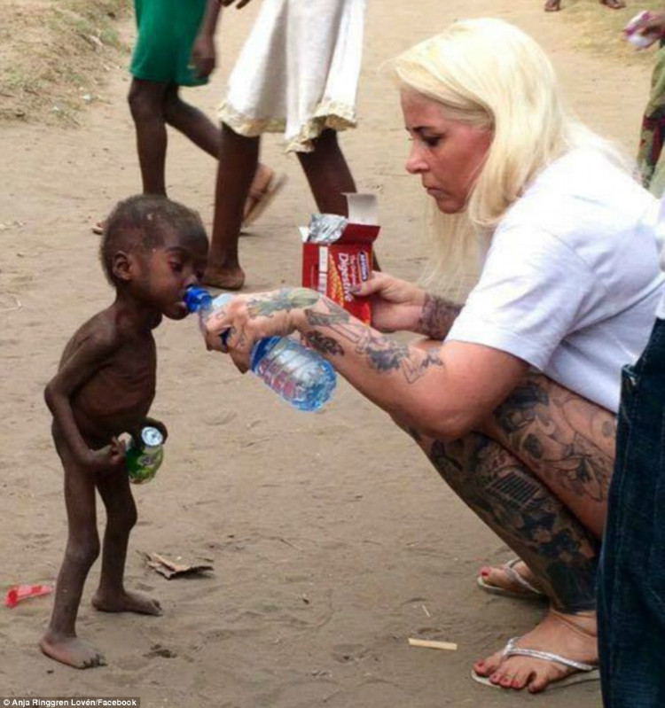 Nigerian boy is given water