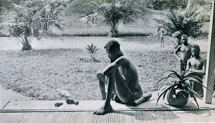 Congolese Man with Daughter's Hand and Foot