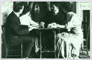 Family playing Ouija board