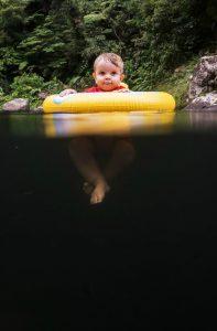 Baby above deep water