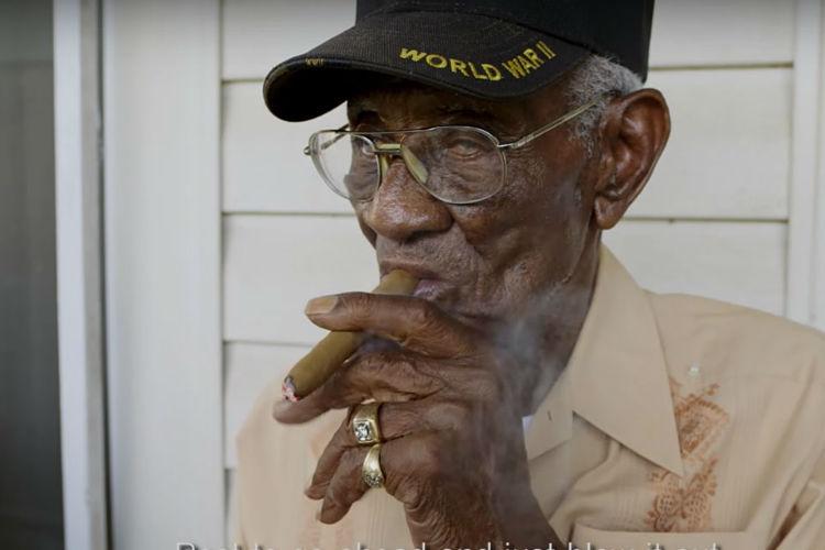 Richard smoking cigar