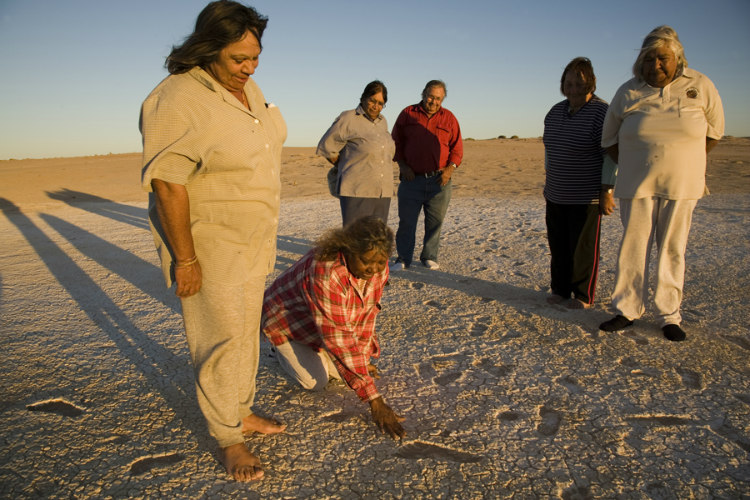 Footprints Being Inspected by Aboriginal Tribes