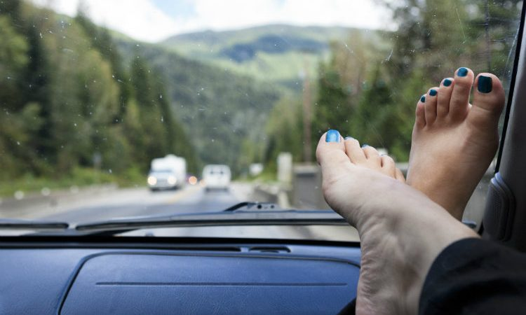 feet up on a car's dashboard