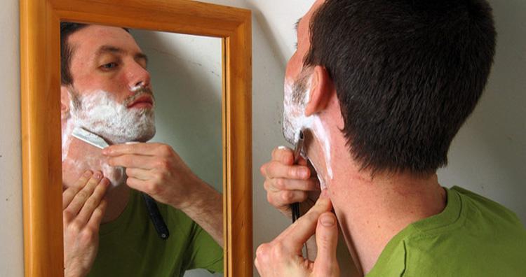 Man Shaving his Hair