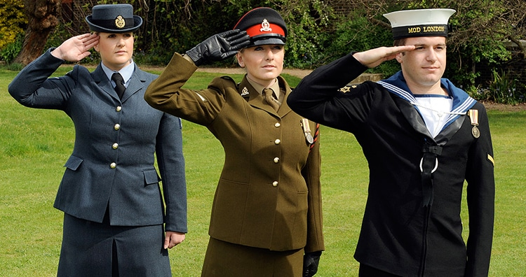 Personnel from the Royal Air Force, the British Army and the Royal Navy saluting