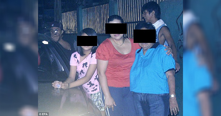 The gunman (left) and his accomplice (right) are captured on the family photo taken by the murdered victim