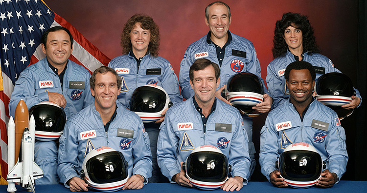 photo of the crew, smiling at the camera just minutes before the explosion