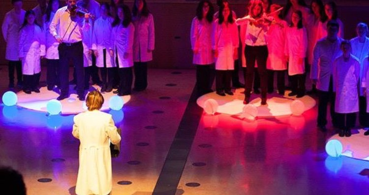 Neil Harbisson conducting musicians with color