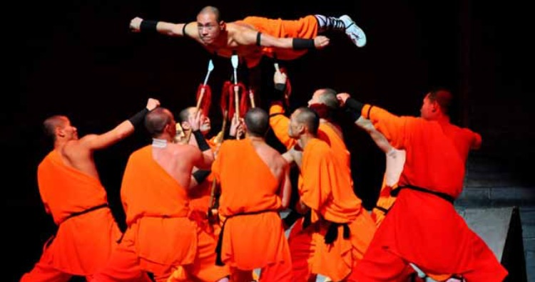A Shaolin Monk suspending himself on spears