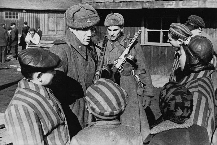 Soviet Soldiers Talking to Children at Auschwitz Just After Liberation
