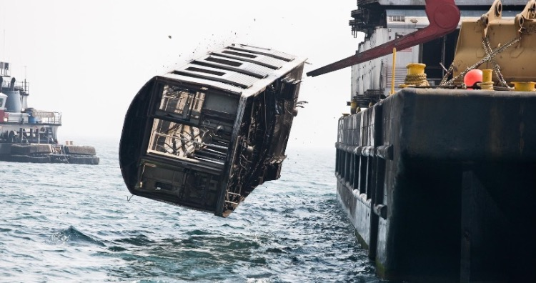 Subway cars being dumped into ocean