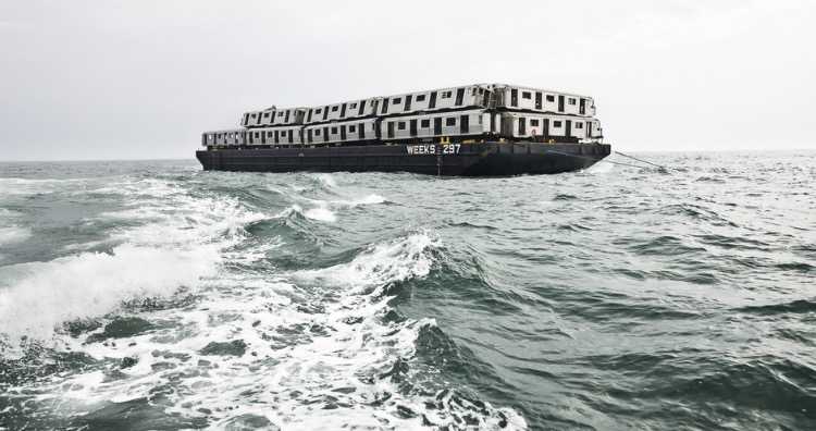 Subway cars on barges