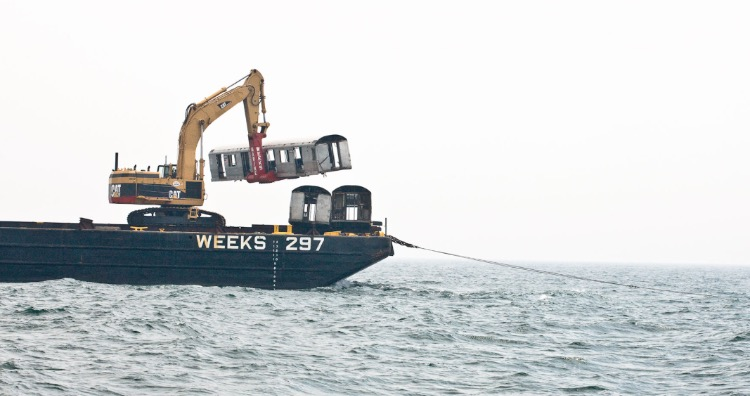 Subway cars being dropped in sea